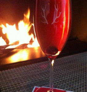 A Kir Royale in front of a roaring fire at Cafe-Bar Artefact in Auberge Saint Antoine