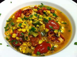 Scallops with Roasted Corn and Tomatoes over Cheese Grits (Photo Credit: Adroit Ideals)