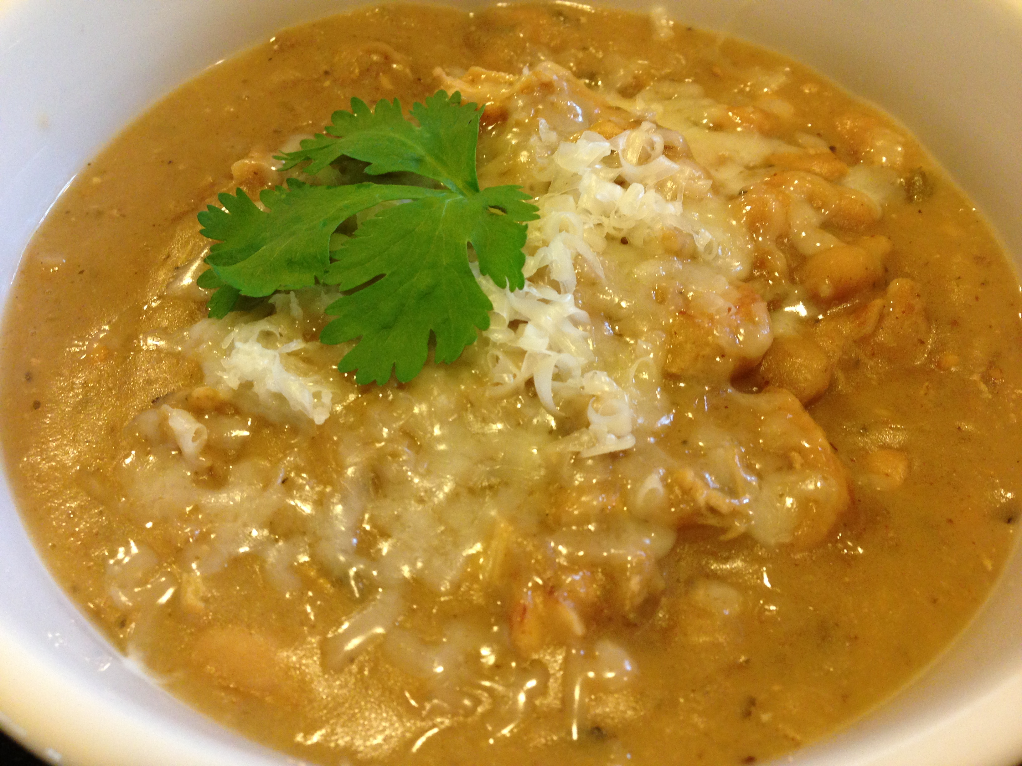 White Chicken Chili with Shredded Monterey Jack (Photo Credit: Adroit Ideals)