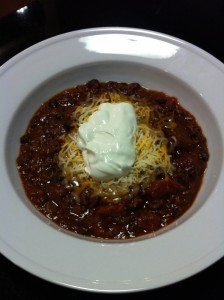 Black Bean Chili with Shredded Cheese and Sour Cream (Photo Credit: Adroit Ideals)
