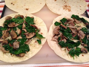 Spinach, mushrooms, garlic, and Monterey Jack cheese make a great quesadilla! (Photo Credit: Adroit Ideals)