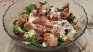 Colorful Garden Salad of Spring Mix, Cucumbers, Tomatoes, Avocado, Garlic Chives, Basil, and Parsley topped with Low Fat Bleu Cheese Dressing and Homemade Croutons (Photo Credit: Adroit Ideals)