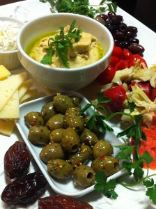 Marinated olives, dates, hummus, smoked salmon, and Manchego cheese (Photo Credit: Adroit Ideals)