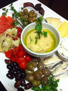 Antipasti: Marinated anchovies, garlic-stuffed olives, Kalamata olives, hummus, smoked salmon, dates (Photo Credit: Adroit Ideals)