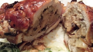 Baked Stuffed Pork Chops  sliced in half to reveal all that stuffing!  (Photo Credit: Adroit Ideals)