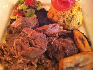 The succulent Cuban Pork entrée with yellow rice and fried plantains at Patsy's Restaurant (Photo Credit: Adroit Ideals)