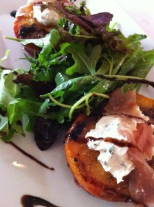 The chilled grilled peach, prosciutto, and herbed cheese appetizer at Patsy's Restaurant (Photo Credit: Adroit Ideals)