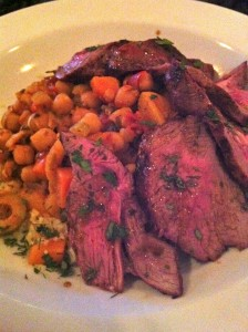 Lamb cooked rare with chickpeas and couscous at Patsy's Restaurant (Photo Credit: Adroit Ideals)