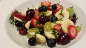 Minty Fruit Salad of bananas, green grapes, strawberries, blueberries, and sweet red cherries.  Sprinkled with mint.  (Photo Credit: Adroit Ideals)