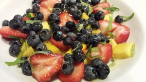 Minty fruit salad with local blueberries and strawberries, mint from my garden, and tropical mango.  (Photo Credit: Adroit Ideals)