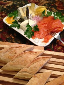 Smoked salmon and assorted cheeses with French baguette served for breakfast (Photo Credit: Adroit Ideals)