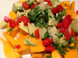 Mangoes, avocadoes, scallions, cilantro, and red bell pepper with a light fruity vinaigrette! (Photo Credit: Adroit Ideals)