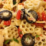 Pizza Pasta Salad with pepperoni, mozzarella, red bell pepper, black olives and Italian Dressing with sundried tomatoes. Starring fiori pasta!  (Photo Credit: Adroit Ideals)