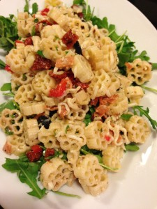 Pizza Pasta Salad served over a bed of fresh peppery Arugula (Photo Credit: Adroit Ideals)
