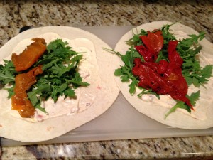 Tortillas spread with Roasted Red Pepper Aioli, topped with roasted red peppers and arugula! (Photo Credit: Adroit Ideals)