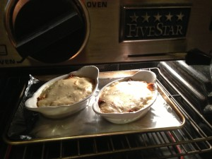 Place the baking dishes with the filled and sauced crepes into the oven (Photo Credit: Adroit Ideals)