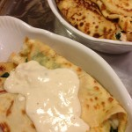 Spoon the white sauce over the smoked chicken crepes (Photo Credit: Adroit Ideals)
