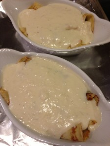 Smoked chicken crepes smothered in white sauce and ready for the oven (Photo Credit: Adroit Ideals)