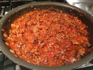 Sloppy Joe filling is reducing over medium-low heat after ketchup and water are added (Photo Credit: Adroit Ideals)