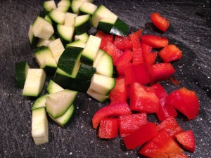Diced zucchini and red bell pepper (Photo Credit: Adroit Ideals)