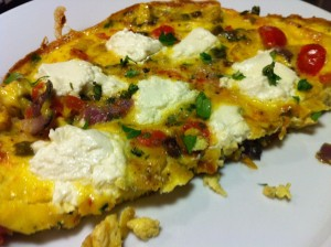 Vegetable Frittata with huge chunks of goat cheese (Photo Credit: Adroit Ideals)