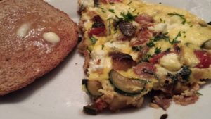 Frittata loaded with veggies and served with buttered toast (Photo Credit: Adroit Ideals)