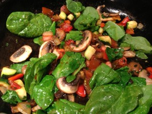 Spinach, mushrooms, tomato, zucchini, onion, red bell pepper, and parsley are sauteed for the Frittata (Photo Credit: Adroit Ideals)