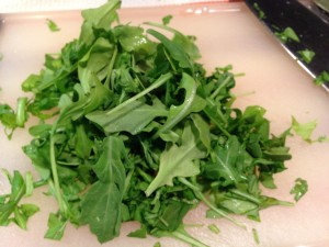 Chop some fresh arugula (Photo Credit: Adroit Ideals)