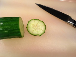 Slice an unpeeled cucumber into rounds, and then slice each round into little triangles (Photo Credit: Adroit Ideals)