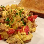 Hearty breakfast of Pulled Smoked Pork Scramble and wheat toast (Photo Credit: Adroit Ideals)