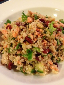 Summer salad that's healthy - Quinoa, salmon, dried cranberries, cucumber, walnuts, arugula, cilantro and a pomegranate vinaigrette (Photo Credit: Adroit Ideals)