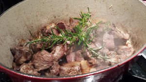 Put one or two sprigs of fresh rosemary and two bay leaves into the pan, and stir (Photo Credit: Adroit Ideals)