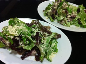 Caesar Salad using baby greens instead of the traditional Romaine lettuce (Photo Credit: Adroit Ideals)