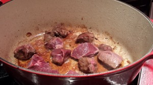 Brown the cubes of venison in some canola oil over medium heat (Photo Credit: Adroit Ideals)