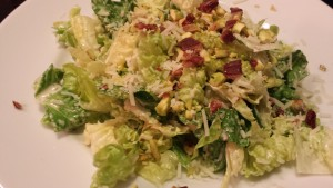 Caesar Salad with Crispy Bacon Crumbles and Toasted Pistachios (Photo Credit: Adroit Ideals)