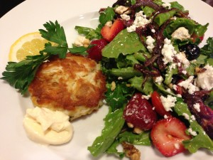 Crab cake with garlic aioli.  Served with a strawberry and mixed greens salad with crumbled goat cheese  (Photo Credit: Adroit Ideals)