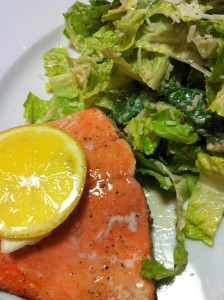 Baked Salmon in Lemon Butter served with Caesar salad (Photo Credit: Adroit Ideals)