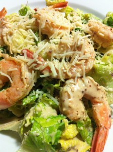 Shrimp Caesar:  Chilled shelled and deveined shrimp served over Caesar salad (Photo Credit: Adroit Ideals)
