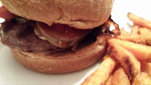 The Best Burger served with sliced ripe tomato and Secret Sauce! (Photo Credit: Adroit Ideals)