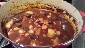Add the potatoes, carrots, and pearl onions to the venison stew (Photo Credit: Adroit Ideals)