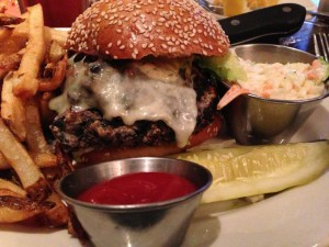 The cheese-laden spicy black bean burger at Wildfire Grill in McLean, VA.  Served with fries, coleslaw, and a dill pickle spear.  Just might entice meatlovers to go vegetarian!  (Photo Credit: Adroit Ideals)