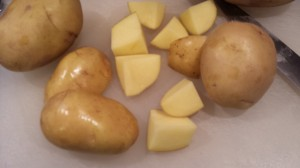 Cut up some Yukon Gold potatoes into about 6 - 8 pieces per potato.  (Photo Credit: Adroit Ideals)