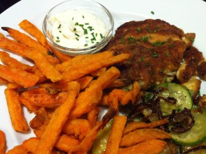 Crab cake served with tartar sauce, sweet potato fries, and sauteed summer squashes (Photo Credit: Adroit Ideals)