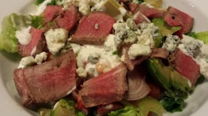 Gorgonzola crumbles and decadent bleu cheese dressing drape a Steak Salad for HER! (Photo Credit: Adroit Ideals)