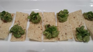 "Guacamole ""spoons"" made from crispy tortilla chips with a dollop of guac on one end. (Photo Credit: Adroit Ideals)"