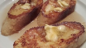 My favorite French toast!  Slathered in butter and swimming in real maple syrup!  (Photo Credit: Adroit Ideals)