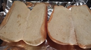 Split sandwich rolls and toast them under the broiler for a few minutes (Photo Credit: Adroit Ideals)