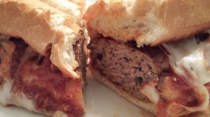 Slice the hearty cheesy tomatoey meatball sandwich in half and get ready to devour it! (Photo Credit: Adroit Ideals)