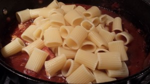 Add the cooked rigatoni to the sauce  (Photo Credit: Adroit Ideals)
