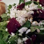 Salad: Roasted Beets with Goat Cheese and Pine Nuts over Arugula (Photo Credit: Adroit Ideals)